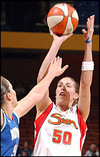 Rebecca Lobo shoots against Lisa Leslie during a game on May 24, 2003